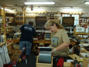A photo of Liz and Carol building machines in the upper shop.