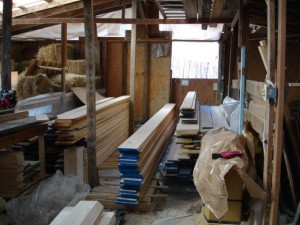 A photo of the barn. All the wood is sourced from US farms and sits in the barn until it's ready to be cut.