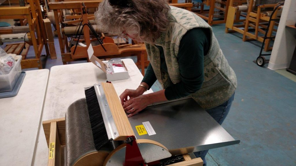Peggy assembling a Strauch Drum Carder