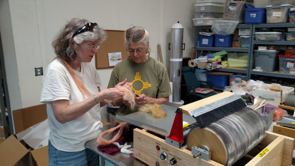 Peggy and Glenna Dean, EVFAC Patron preparing fiber for the first batt