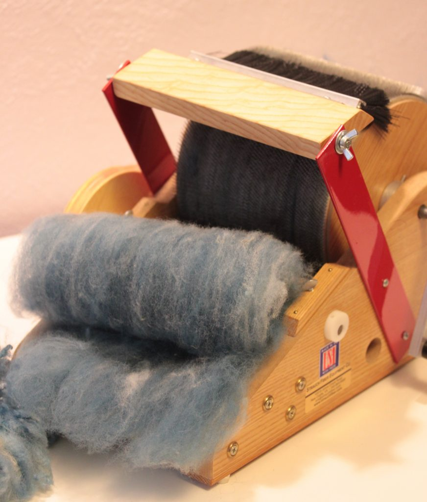 This heathered blue batt was made easily on the Strauch Petite Drum Carder.