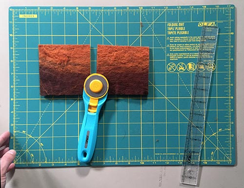 How to Wet Felt Coasters from Carded Batts - cutting squares to make felted coasters