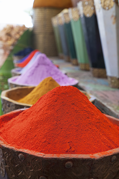 Vertical shot of natural dyes, colorful and vibrant pigment powd