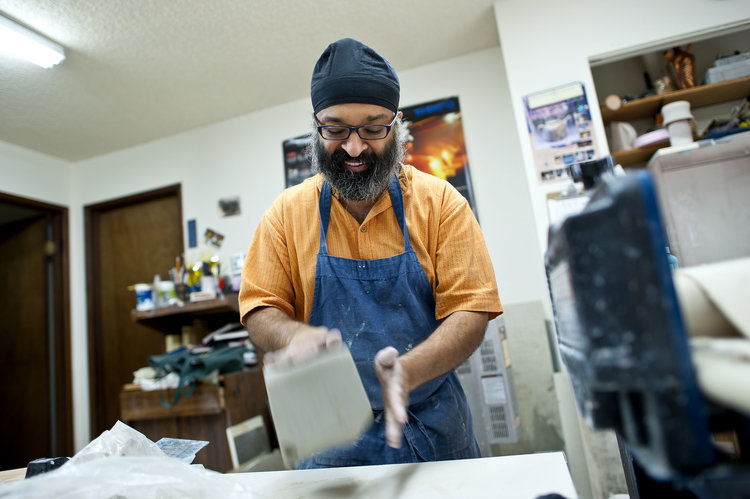 Charan Sachar working with clay